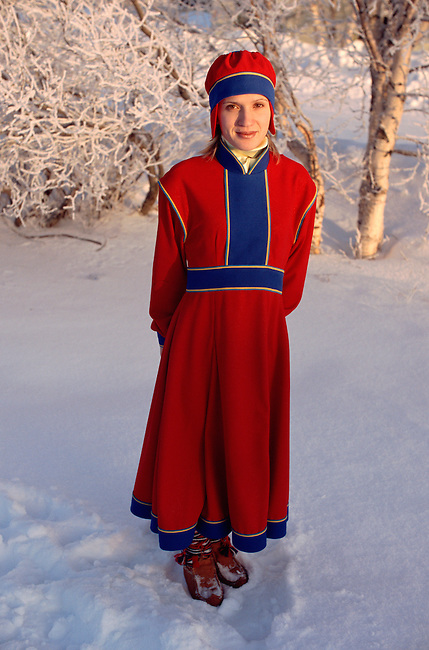 A Sami woman wearing a replica of traditional Kola Peninsula Sami dress. Sami Culture Centre, Lovozero. Murmansk, NW Russia