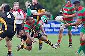 Willie Heperi gets the ball away to Tevita Finau as he is upended by Joe Heta. Counties Manukau Premier Club Rugby game between Waiuku and Bombay, played at Waiuku on Saturday July 5th 2010. Waiuku won 59 - 14 after trailing 12 - 14 at halftme.