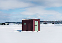 Ice house huts at the 39th Annual International Eelpout Festival, at Leech Lake in Walker, Minnesota, February 23, 2018. Crowds that are more than 10 times the population of tiny Walker, Minn. (pop. 1,069) gather on Minnesota&rsquo;s third largest lake (112,000-acres), Leech Lake, for a festival named for one of the ugliest bottom-dwelling fish, the eelpout.<br /> <br /> Photo by Matt Nager