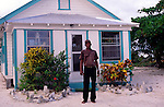 Local man and his house, Cayman Brac, Cayman Islands, British West Indies,
