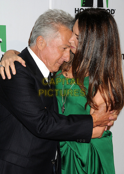 Dustin Hoffman & Lisa Gottsegen.16th Annual Hollywood Film Awards Gala held at the Beverly Hilton Hotel, Beverly Hills, California, USA..October 22nd, 2012.half length green dress married husband wife black white shirt suit profile hug embrace funny kiss kissing  .CAP/ADM/BP.©Byron Purvis/AdMedia/Capital Pictures.