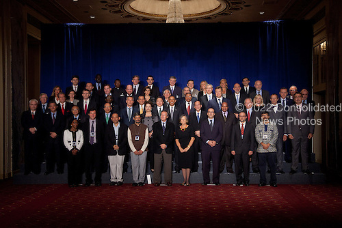 United States President Barack Obama, center poses for a group photo with other world leaders participating in the Open Government Partnership, a global effort to make governments better, at the Waldorf-Astoria in New York, New York on Tuesday, September 20, 2011..Credit: Allan Tannenbaum / Pool via CNP
