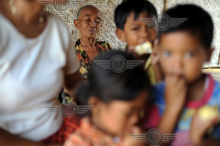 A family of Internally Displaced People (IDPs) in Besuki Village. Since May 2006, more than 10,000 people in the Porong subdistrict of Sidoarjo have been displaced by hot mud flowing from a natural gas well that was being drilled by the oil company Lapindo Brantas. The torrent of mud - up to 125,000 cubic metres per day - continued to flow three years later.