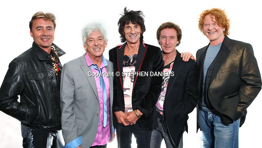 PHOTO BY © STEPHEN DANIELS    05/08/2010 <br /> The Faces at O2 Dome Arena, London. Kenney Jones, Ronnie Wood, Ian McLagan (Pink shirt), Mick Hucknall, Glen Matlock & Jesse Wood (Black shirt & white tie)