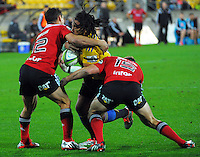 Dan Carter and Tom Taylor tackle Ma'a Nonu during the Super Rugby match between the Hurricanes and Crusaders at Westpac Stadium, Wellington, New Zealand on Saturday, 2 May 2015. Photo: Dave Lintott / lintottphoto.co.nz