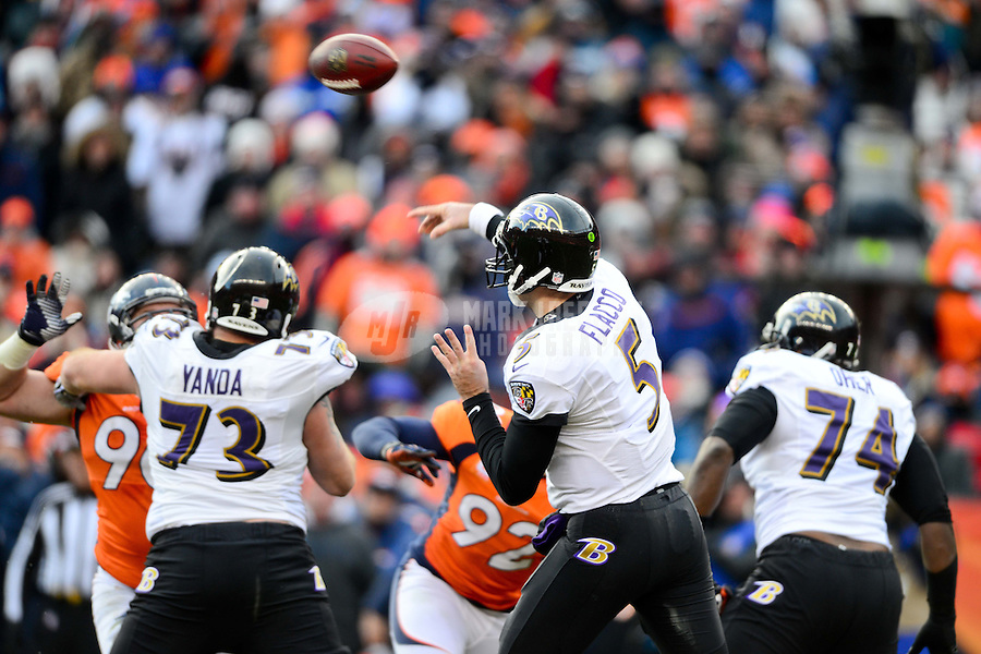 Jan 12, 2013; Denver, CO, USA; Baltimore Ravens quarterback Joe Flacco (5) throws a pass in the first half against the Denver Broncos during the AFC divisional round playoff game at Sports Authority Field.  Mandatory Credit: Mark J. Rebilas-