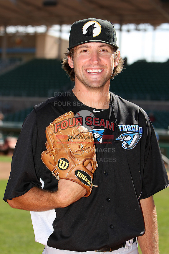 Phoenix Desert Dogs pitcher Evan Crawford #39 poses for a photo before an Arizona Fall League game against the Mesa Solar Sox at HoHoKam Park on November 3, 2011 in Mesa, Arizona.  Mesa defeated Phoenix 8-7.  (Mike Janes/Four Seam Images)