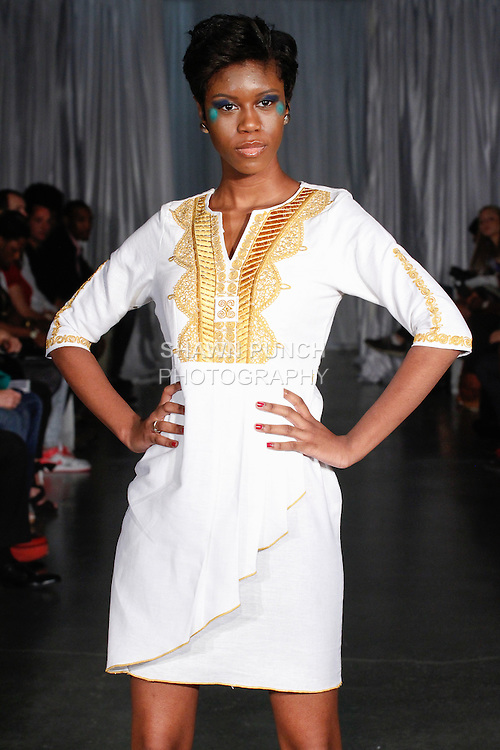 Model walks runway in an outfit from the Nallem Clothing Spring Summer 2014 collection by Gregory A. Kankoh, during Fashion Week Brooklyn Spring Summer 2014, in Brooklyn, New York on October 5, 2013.
