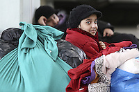 Pictured: A migrant girl in the passenger station Monday 08 Fabruary 2016<br /> Re: Migrants wait in the Piraeus passenger station to be transported to the migrants' camp in Elliniko, Athens, Greece