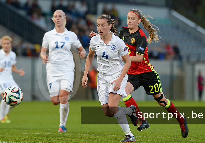 20160412 - LEUVEN ,  BELGIUM : Belgian Julie Biesmans (20) pictured hunting on Estonian Pille Raadik (4) during the female soccer game between the Belgian Red Flames and Estonia , the fifth game in the qualification for the European Championship in The Netherlands 2017  , Tuesday 12 th April 2016 at Stadion Den Dreef  in Leuven , Belgium. PHOTO SPORTPIX.BE / DAVID CATRY