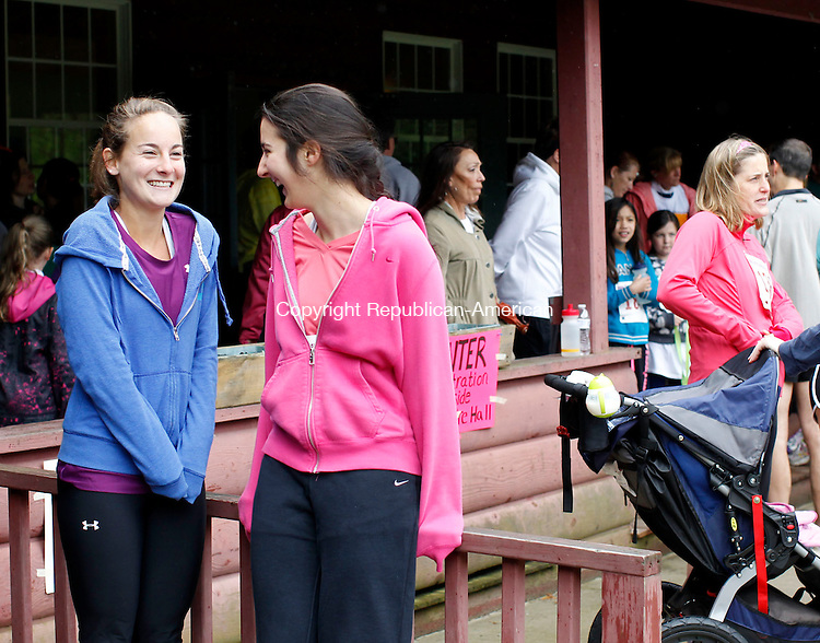 New Hartford, CT- 01 May 2013-052613CM01-  Lauren Silverio, left, and Lindsay Dezi, of New Hartford share a laugh before the start of the Race Around the Lake, sponsored by Friends of Brodie Park & New Hartford Recreation Commission Sunday morning.  Participants made their way around  scenic West Hill Lake, an event held annually on Memorial Day weekend.  Christopher Massa Republican-American