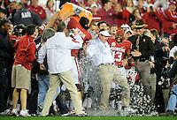 Jan. 1, 2011; Glendale, AZ, USA; Oklahoma Sooners head coach Bob Stoops is doused with gatorade in the closing seconds of the game against the Connecticut Huskies in the 2011 Fiesta Bowl at University of Phoenix Stadium. The Sooners defeated the Huskies 48-20. Mandatory Credit: Mark J. Rebilas-