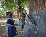 A girl learns her numbers in an outdoor classroom in a primary school in Bunj, South Sudan, sponsored by Jesuit Relief Service. The community is host to more than 130,000 refugees from the Blue Nile region of Sudan. JRS, with support from Misean Cara, provides educational and psycho-social services to both refugees and the host community.