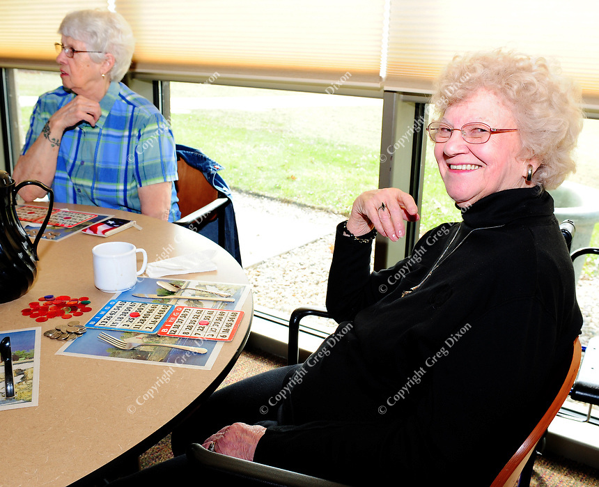 Becky Bryant plays bingo Friday morning at the Warner Park Community & Recreation Center, which is celebrating its 10th anniversary
