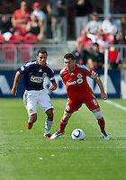 07 August 2010: Chivas USA defender Jonathan Bornstein #13 and Toronto FC defender Dan Gargan #8 in action during a game between Chivas USA and Toronto FC at BMO Field in Toronto..Toronto FC won 2-1.