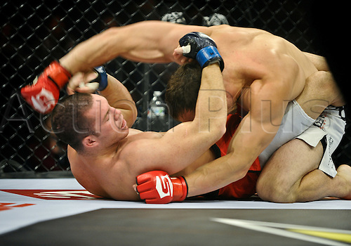 24.06.2011, Washinton, USA.  Trevor Smith delivers a blow to Keith Berry during the STRIKEFORCE Challengers at the ShoWare Center in Kent, Washington. Smith choked out Berry in the second round.