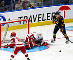 January 26, 2020:   Sacred Heart goalie Josh Benson makes one of his 21 saves as the Pioneers upset 17th ranked Quinnipiac 4-1. The inaugural event was held at the Webster Bank Arena in Bridgeport, Connecticut.  Heary/Eclipse Sportswire/CSM