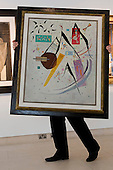 Pictured: A Christie's Specialist is handling the painting Schwarze Spitzen 1937 by Kandinsky. Estimated to fetch $4-6 million. <br /> <br /> Christie's London unveils touring highlights from the New York &quot;Impressionist &amp; Modern Art Evening Sale&quot; which are on free public view from 28 March to 1 April, ahead of the auction in New York on 6 May 2014.
