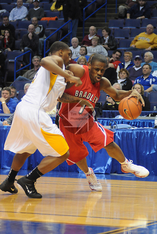 March 4,  2011          Bradley Braves guard Dodie Dunson (1) dribbles around Wichita State Shockers guard Joe Ragland (1) in the first half. Wichita State played Bradley University in the third quarterfinal game of the NCAA Missouri Valley Conference Men's Basketball Tournament on Friday March 4, 2011 at the Scottrade Center in downtown St. Louis.