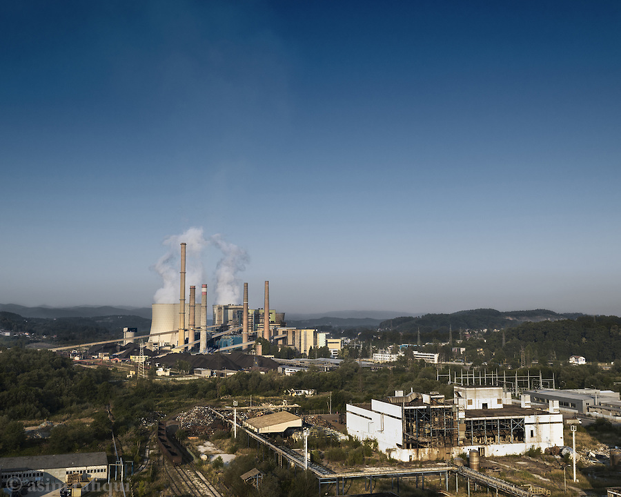 A view of the Tuzla industrial area, with the main coal fired power plant in the background, and the privatised, stripped and destroyed factory grounds of Polihem in the foreground.