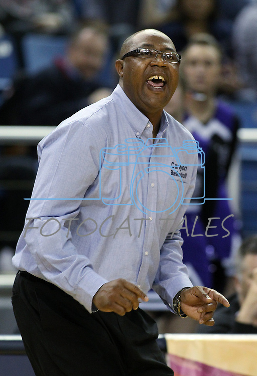 Canyon Springs Head Coach Freddie Banks works the sidelines of a Division I semi-final game in the NIAA basketball state tournament at Lawlor Events Center, in Reno, Nev., on Thursday, Feb. 27, 2014. Canyon Springs defeated Spanish Springs 66-51. (Cathleen Allison/Las Vegas Review-Journal)