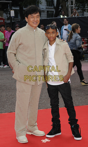 "JACKIE CHAN & JADEN SMITH.The Gala Premiere of ""The Karate Kid"", Odeon Leicester Square, London, England, UK. .15th July 2010 .full length white cream beige jacket sunglasses shirt black trousers suit trainers hand in pocket.CAP/CAN.©Can Nguyen/Capital Pictures."