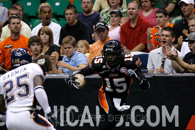 Utah's Huey Whittaker, #15, runs past Colorado's Jason Harmon, #25, during the second half of the game at the EnergySolutions arena Saturday, June 28, 2008. The Blaze lost the game 44-49...Photo by Chris Detrick/The Salt Lake Tribune.frame #_2CD6526.