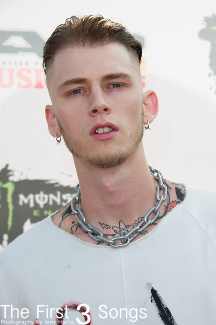 Machine Gun Kelly (Richard Colson Baker) attends the 2014 AP Music Awards at the Rock And Roll Hall Of Fame and Museum at North Coast Harbor in Cleveland, Ohio.
