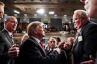 FEBRUARY 5, 2019 - WASHINGTON, DC: President Trump shook hands with Representative Billy Long, R-MO, after the State of the Union at the Capitol in Washington, DC on February 5, 2019. (Doug Mills/The New York Times POOL PHOTO) NYTSOTU / MediaPunchCAP/MPI/RS<br /> ©RS/MPI/Capital Pictures