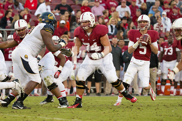 Stanford, CA -- November 23, 2013:  Stanford's Evan Crower with protection from Brendon Austin during a game against Cal at Stanford Stadium. Stanford defeated Cal 63-13.