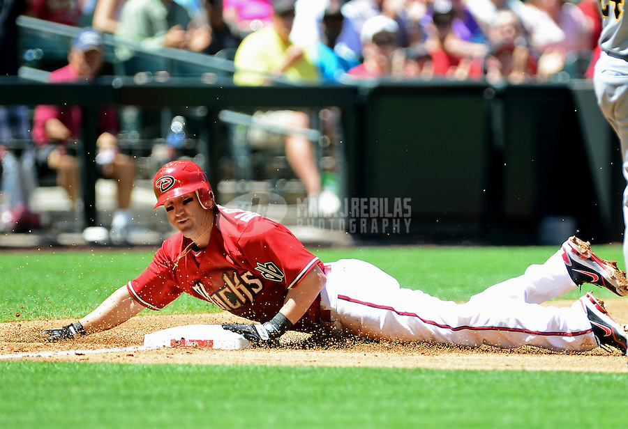 Apr. 18, 2012; Phoenix, AZ, USA; Arizona Diamondbacks base runner Willie Bloomquist slides safely into third base with a triple in the first inning against the Pittsburgh Pirates at Chase Field. Mandatory Credit: Mark J. Rebilas-