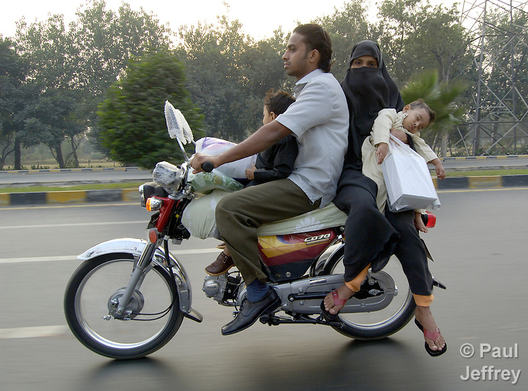 A family traveling together in Lahore, Pakistan.