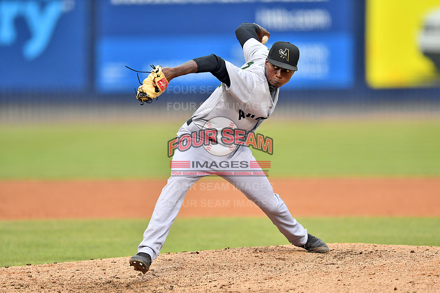 Augusta GreenJackets relief pitcher Sandro Cabrera (28) delivers a pitch during a game against the Asheville Tourists at McCormick Field on July 13, 2019 in Asheville, North Carolina. The GreenJackets defeated the Tourists 6-4. (Tony Farlow/Four Seam Images)