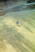 Man on Lumahai beach, North shore, Kauai