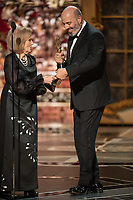 Mark Bridges accept the Oscar&reg; for Achievement in costume design, for work on &ldquo;Phantom Thread&rdquo; during the live ABC Telecast of The 90th Oscars&reg; at the Dolby&reg; Theatre in Hollywood, CA on Sunday, March 4, 2018.<br /> *Editorial Use Only*<br /> CAP/PLF/AMPAS<br /> Supplied by Capital Pictures