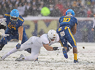 Philadelphia, PA - December 9, 2017:   Navy Midshipmen running back Malcolm Perry (10) gets tackled by a Army Black Knights defender during the 118th game between Army vs Navy at Lincoln Financial Field in Philadelphia, PA. (Photo by Elliott Brown/Media Images International)