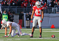 Ohio State Buckeyes linebacker Darron Lee (43) shakes his head after interfering on a pass to Indiana Hoosiers tight end Jordan Fuchs (81) in the fourth quarter of their game at Ohio Stadium in Columbus, Ohio on November 22, 2014. (Columbus Dispatch photo by Brooke LaValley)