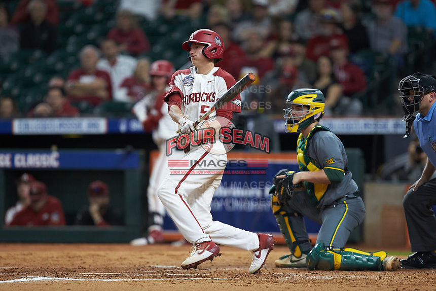 Jacob Nesbit (5) of the Arkansas Razorbacks follows through on his swing against the Baylor Bears in game nine of the 2020 Shriners Hospitals for Children College Classic at Minute Maid Park on March 1, 2020 in Houston, Texas. The Bears defeated the Razorbacks 3-2. (Brian Westerholt/Four Seam Images)