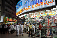 United Arab Emirates, Dubai: Electronic shops at night along Al Faheidi Street