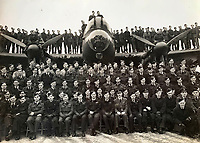 BNPS.co.uk (01202 558833)<br /> Pic:  DavidLay/BNPS<br /> <br /> Flight Sergeant Douglas Alexander's entire squadron on one of their Lancaster bombers.<br /> <br /> Bomber command heroes WW2 exploits discovered in a shoebox.<br /> <br /> The personal effects of a fearless 'Tail-end Charlie' have been discovered in a shoebox - and they include a charming set of photos of his wartime service.<br /> <br /> Flight Sergeant Douglas Alexander, of 460 Squadron, took part in nearly 40 bombing raids over Germany, including the famous assault on Hitler's mountain retreat, Berchtesgaden.<br /> <br /> As a tail gunner, he sat in a tiny glass turret at the rear of Lancaster and Halifax bombers - a terribly exposed position.<br /> <br /> The shoebox, containing his bravery medals, logbooks and photos, was bought into auctioneer David Lay Frics, of Penzance, Cornwall, by his daughter.<br /> <br /> Flt Sgt Alexander's medal group includes the prestigious Distinguished Flying Medal, awarded for 'exceptional valour, courage and devotion to duty', with his photos capturing the camarederie which existed in the RAF as the airmen risked their lives on every mission to defeat Adolf Hitler.