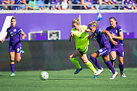 Orlando, Florida - Sunday, May 8, 2016: Seattle Reign FC forward Beverly Yanez (17) has her shirt grabbed by Orlando Pride defender Monica Hickman Alves (21) as she tries to dribble by her during a National Women's Soccer League match between Orlando Pride and Seattle Reign FC at Camping World Stadium.