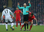 Philippe Coutinho of Liverpool gets stuck behind referee Anthony Taylor as Didier Ndong of Sunderland picks up the loose ball during the Premier League match at the Anfield Stadium, Liverpool. Picture date: November 26th, 2016. Pic Simon Bellis/Sportimage