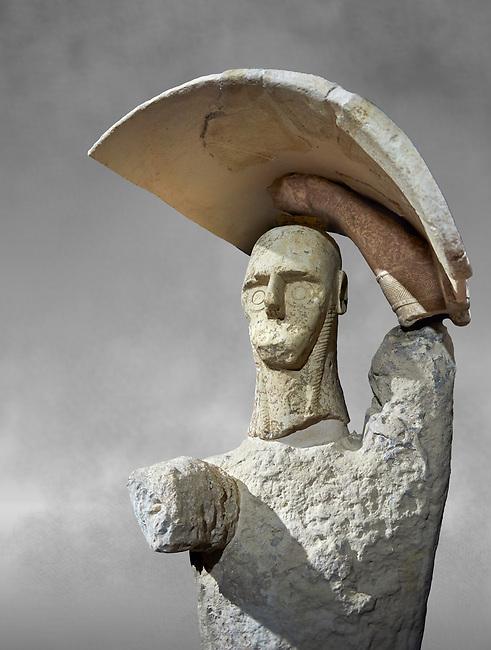 9th century BC Giants of Mont'e Prama  Nuragic stone statue of a boxer, Mont'e Prama archaeological site, Cabras. 2014 excavation. Civico Museo Archeologico Giovanni Marongiu - Cabras, Sardinia. Art grey background