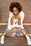 African American woman sitting and smiling