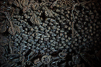 There is an unquantifiable collection of hooks used to transport the beef along the productive process. Frigorifico (Slaughterhouse) Anglo, Fray Bentos, Rio Negro, Uruguay.  ..Existe aún una colección incuantificable de fanos utilizados para colgar las reses y desplazarlas a lo largo de todo el proceso productivo.  Frigorifico Anglo, Fray Bentos, Río Negro, Uruguay.