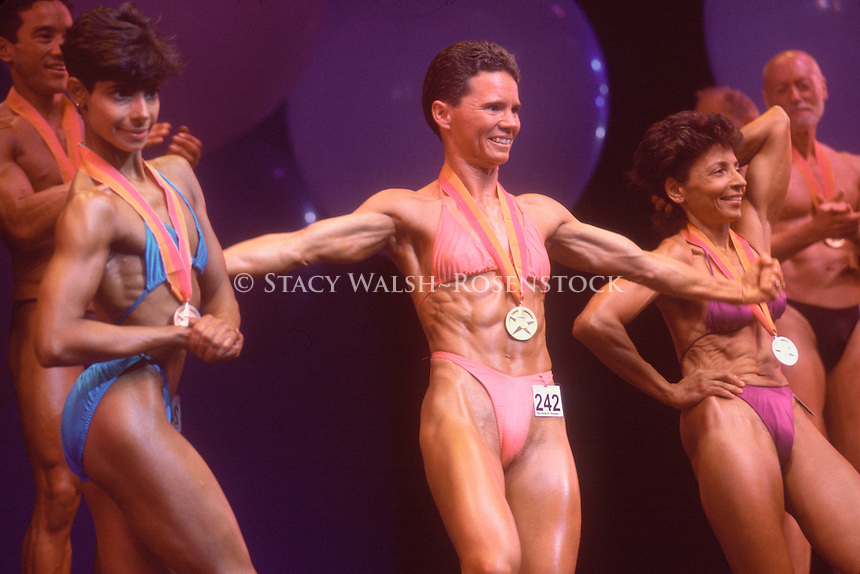 (02000811-SWR089.jpg) New York, NY - June '94 -Men and women bodybuilders in the Physiques competition of Gay Games at the Paramount in Madison Square Garden...© Stacy Walsh Rosenstock