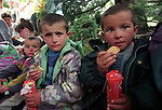 BAJRAM CURRI - ALBANIA - 20 JUNE 1998 -- Kosovo- Albanian refugees from Decani, after4 days by foot through the mountains tired and hungry in the center of Bajram Curri. -- PHOTO: JUHA ROININEN / EUP-IMAGES