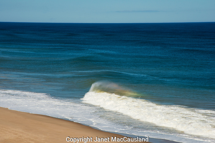 Cape Cod National Seashore; swells; rolling; waves; prism; spectrum; rainbow; wind; windy; cresting; blue; sunny; October; beach; cliffs; banking; embankment; overlook; view; scenic;