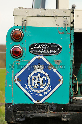 Rear wing panel with age related RAC logo of 1958 2.0 Liter Diesel Land Rover Series 2 SWB 88 recovery truck with Harvey Frost crane in very original condition with two colour paint sheme in light blue and white showing the golden company name Handman & Collis Recovery. UK 2005 Dunsfold.