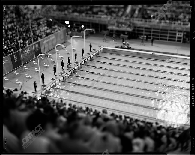Judges stand at the ready at the beginning of the men's breaststroke rounds. Summer Olympics, Athens, Greece, August, 2004.